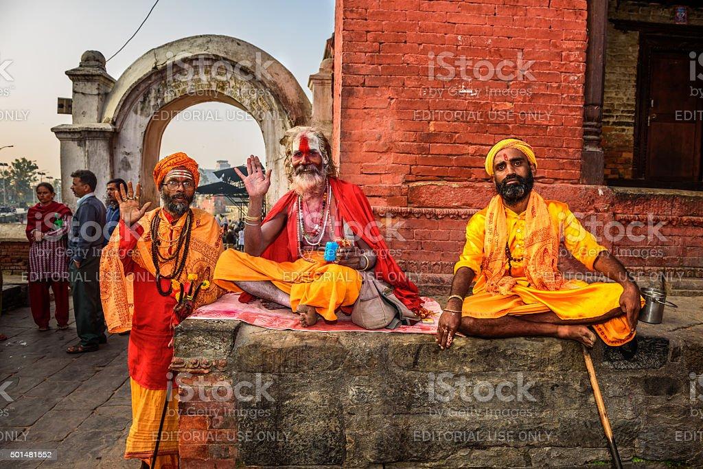 Three Shaiva sadhus in ancient Pashupatinath Temple, Kathmandu, Nepal stock photo