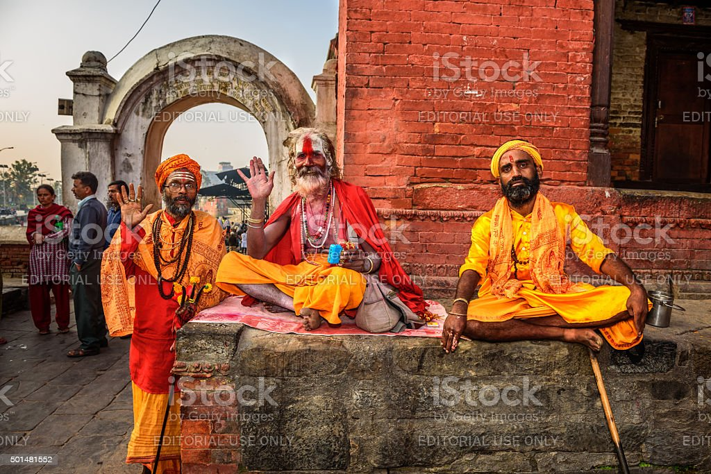 Three Shaiva sadhus in ancient Pashupatinath Temple, Kathmandu, Nepal stock photo