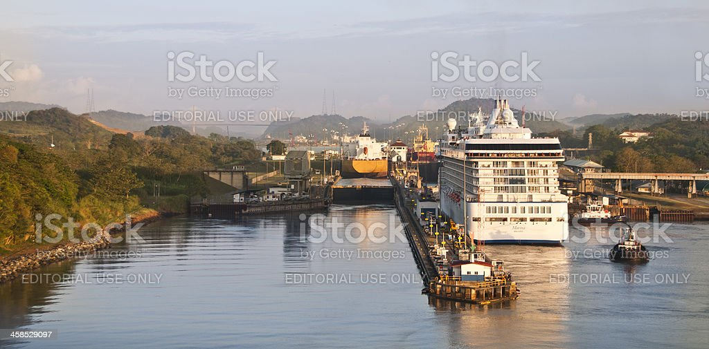 Three Ships Traverse the Miraflores Locks of Panama Canal stock photo