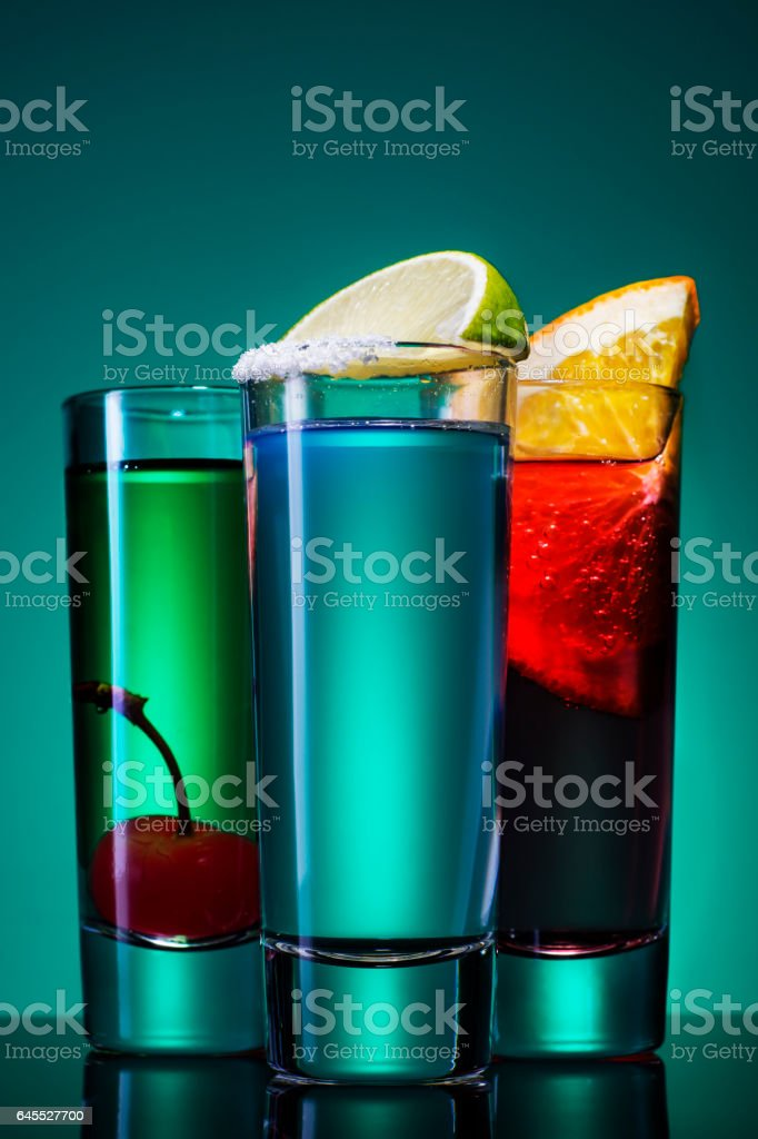 Three short cocktail on a blue background stock photo
