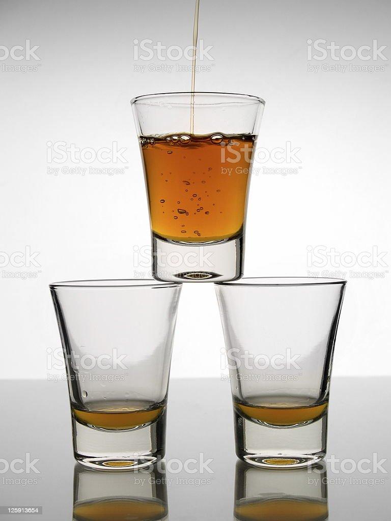 Three shots of whisky stock photo