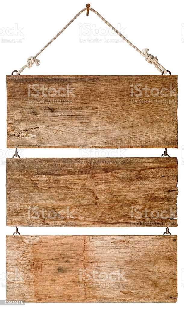 Three signs of weathered wood hanging from an old nail. stock photo