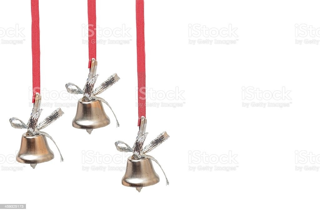 three silver bells on red ribbons stock photo