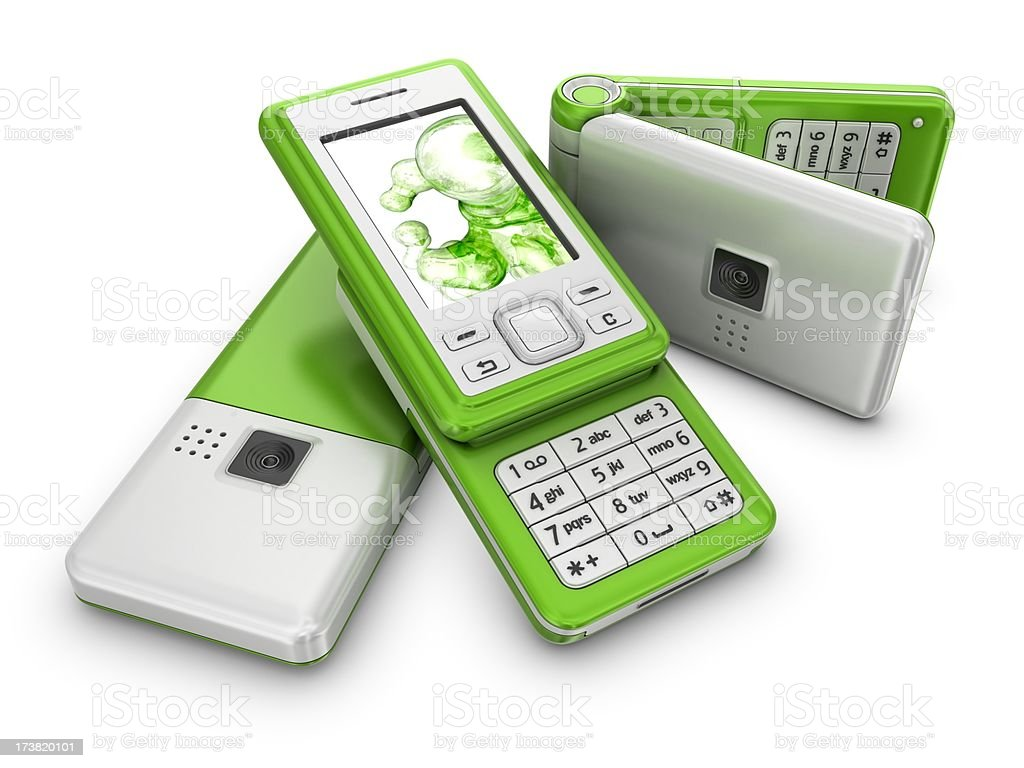 three silver-green mobile phones royalty-free stock photo