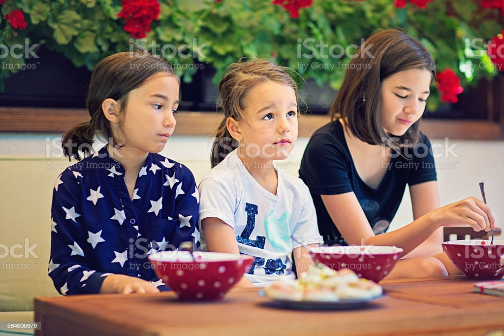 Three sisters don`t like their breakfast. stock photo