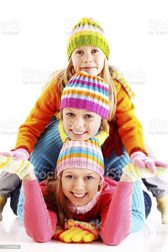 Three sisters making a human pyramid. royalty-free stock photo