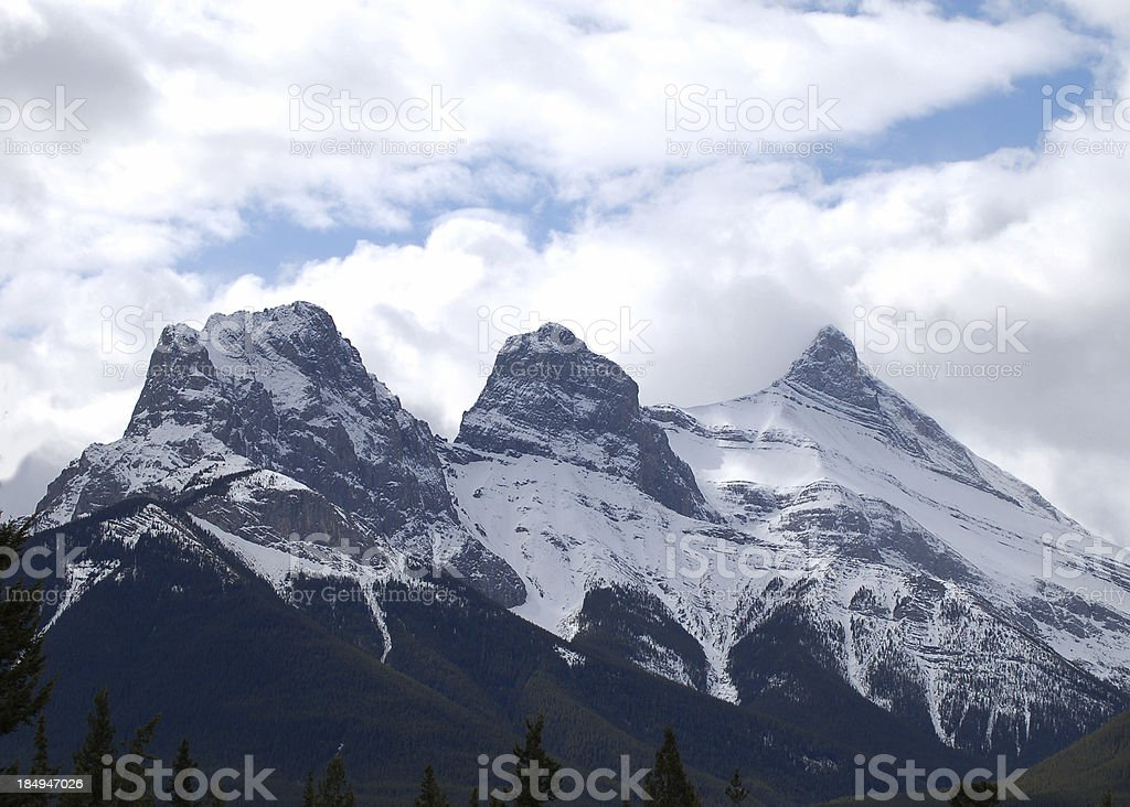 Three Sisters on a Cloudy Day Rocky Mountains royalty-free stock photo