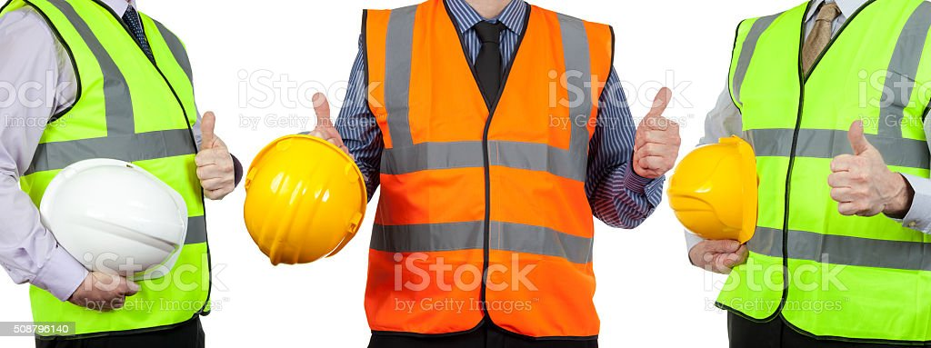 Three site surveyors in high visibility vests giving the thumbs stock photo