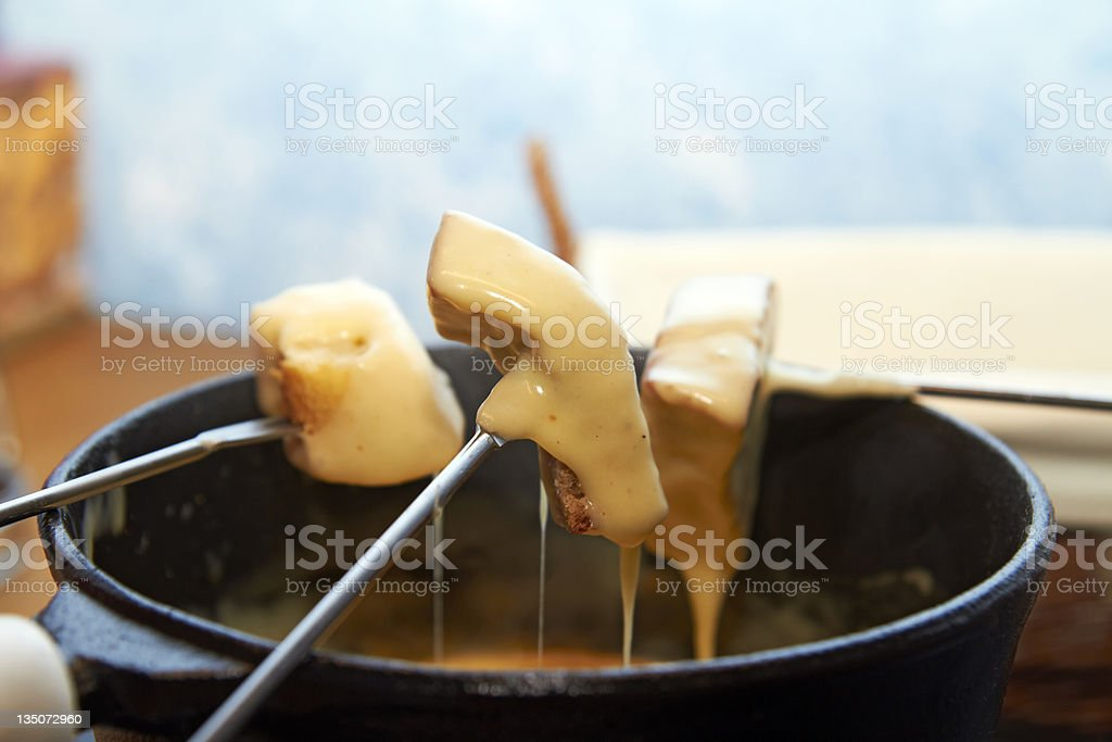 Three skewers of cheese fondue stock photo