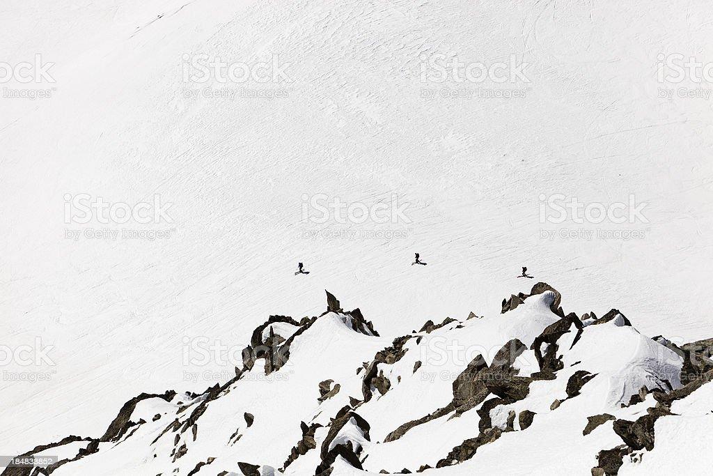 Three Skiers on the Mont Blanc Massif stock photo