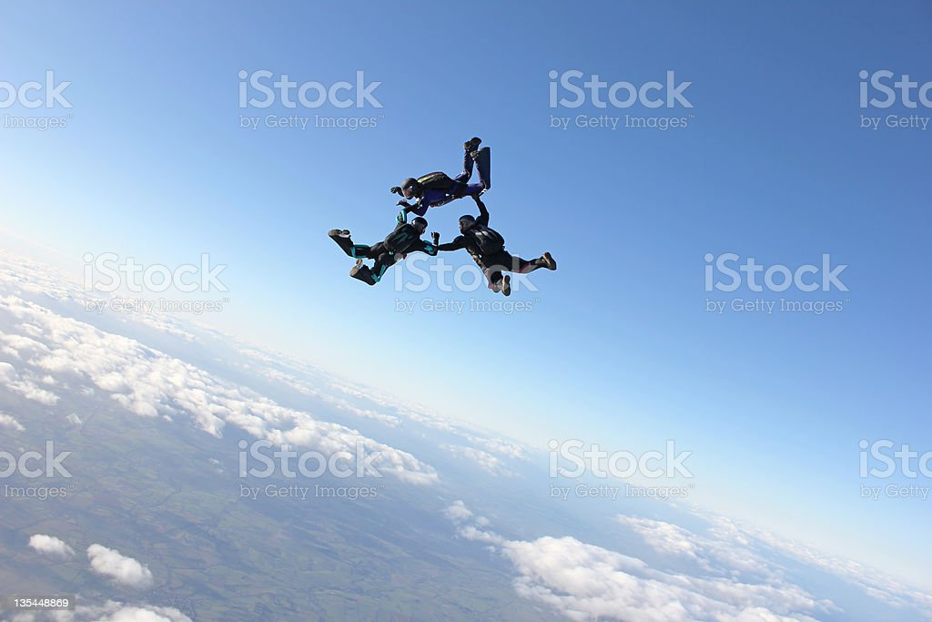 Three skydivers after existing an airplane stock photo