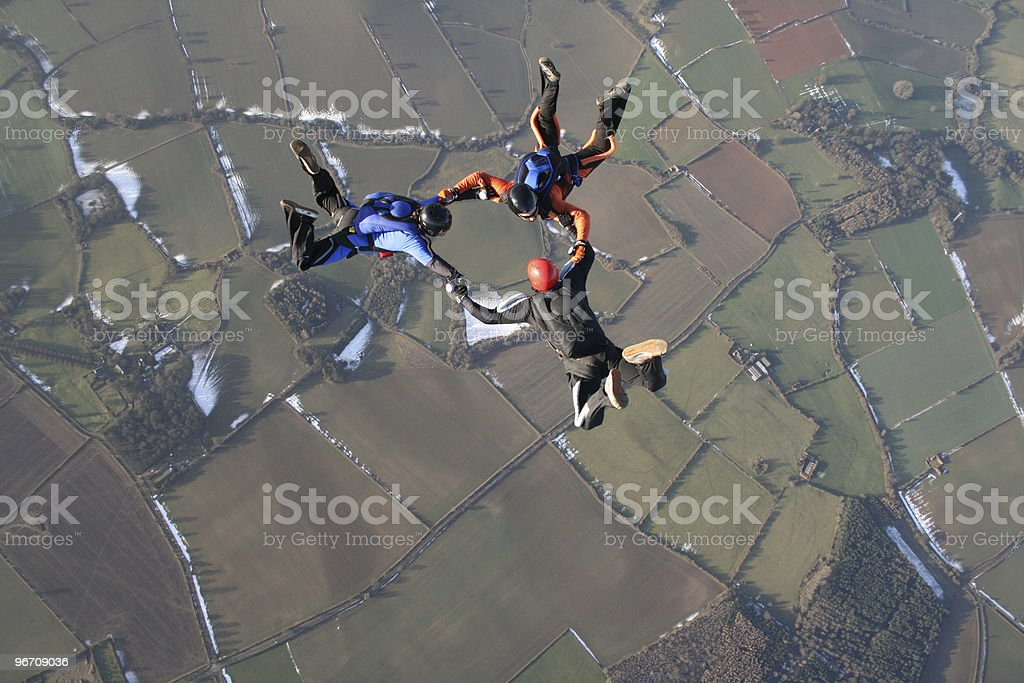 Three skydivers in freefall royalty-free stock photo