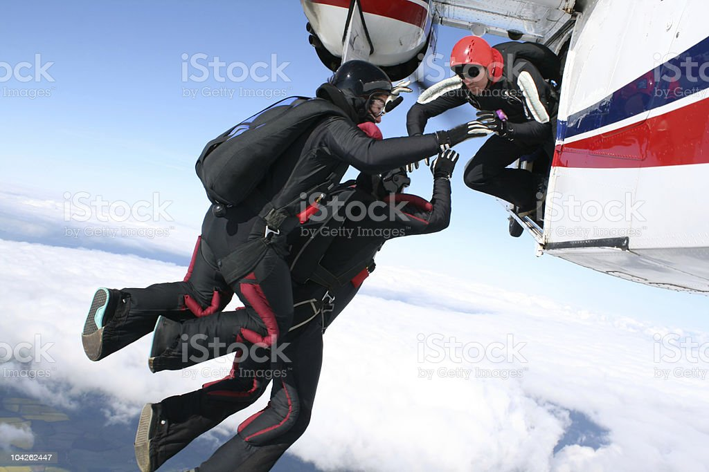 Three skydivers jump form a plane royalty-free stock photo