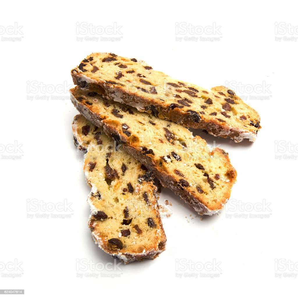 Three slices of christmas stollen on a white background stock photo