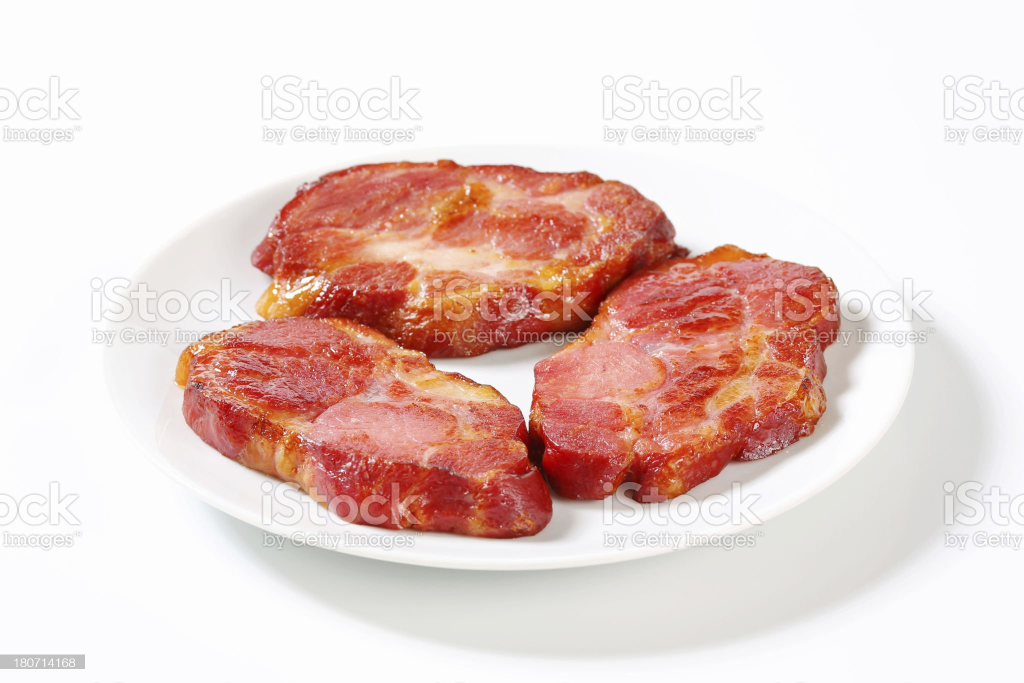 Three slices of grilled pork neck on a plate royalty-free stock photo