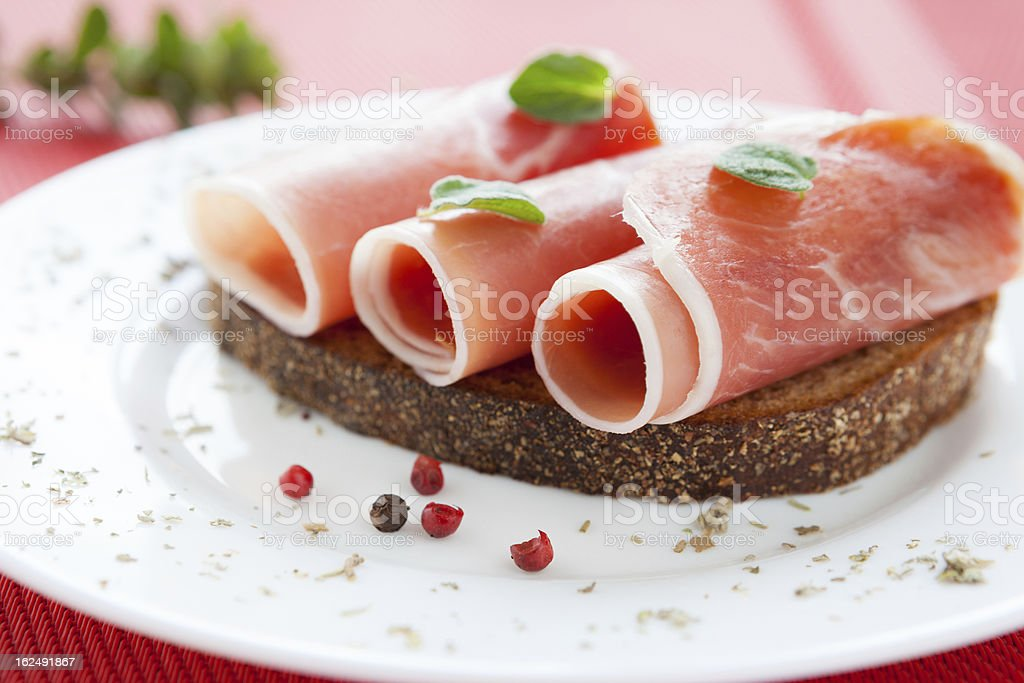 three slices of ham wrapped in a roll royalty-free stock photo