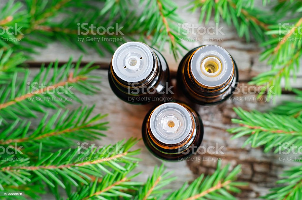 Three small bottles of essential spruce (fir) oil stock photo