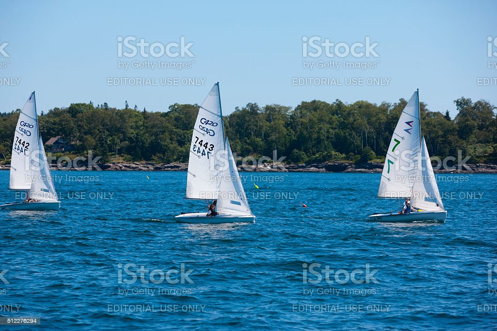 Three small sailboats with spinnakers stock photo