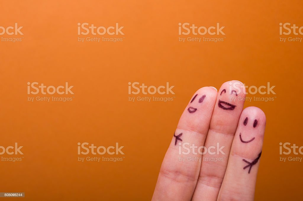 three smiling fingers that are very happy to be friends stock photo