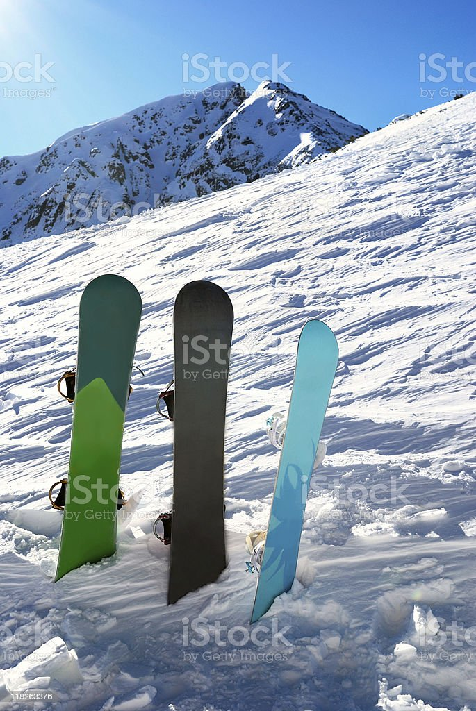 Three snowboards under sun royalty-free stock photo