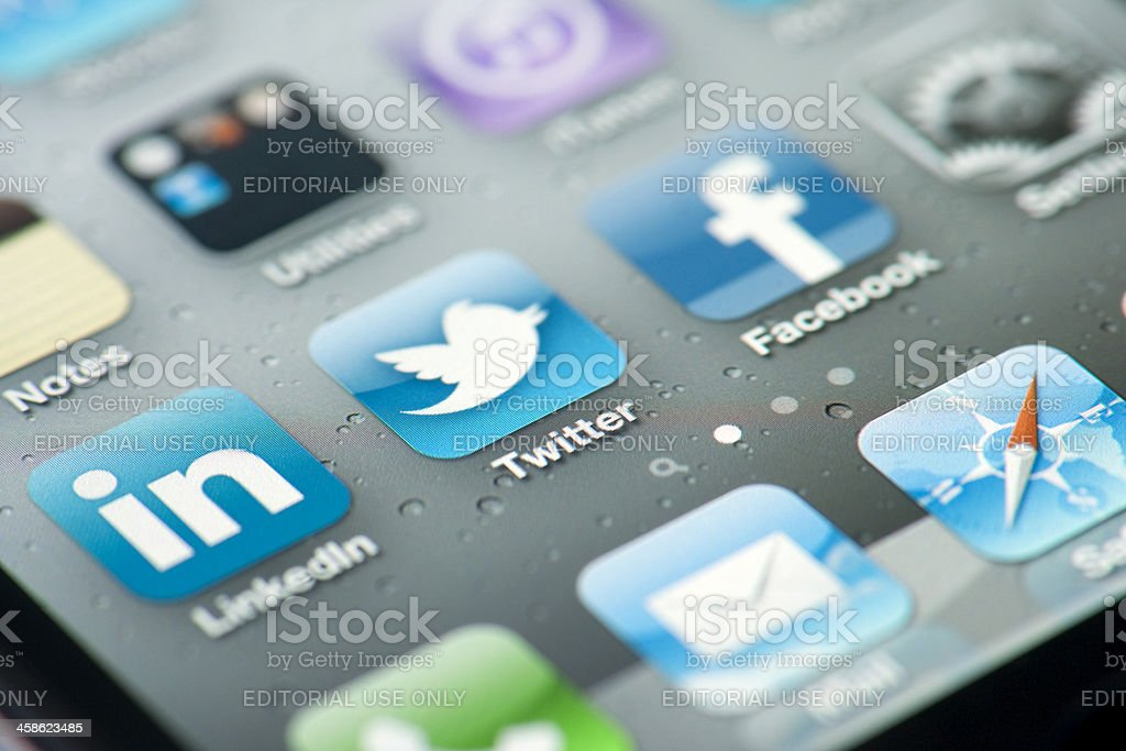 Three social media icons on iPhone screen royalty-free stock photo