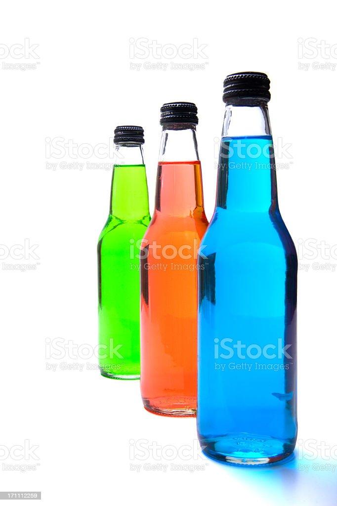 Three soda bottles in green, orange and blue stock photo