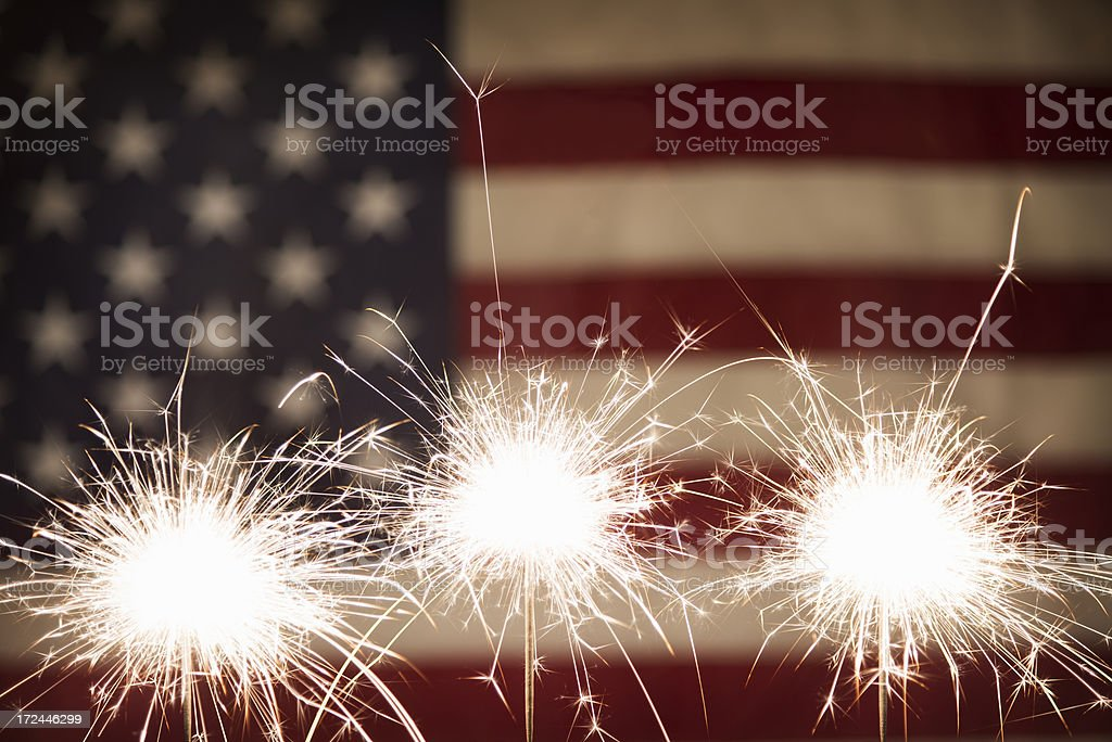 Three Sparklers with American Flag royalty-free stock photo