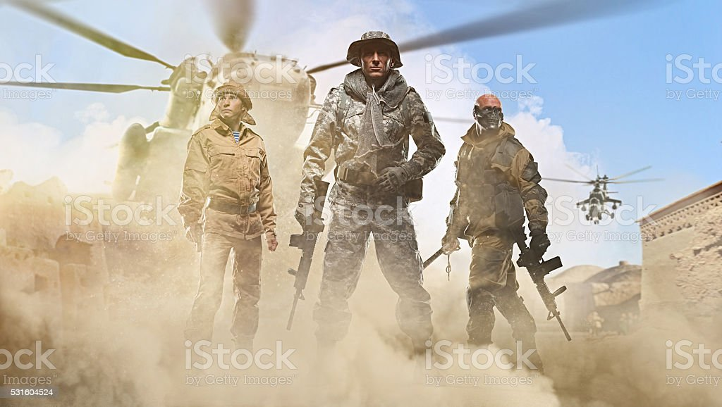 Three special forces men on Arab street stock photo