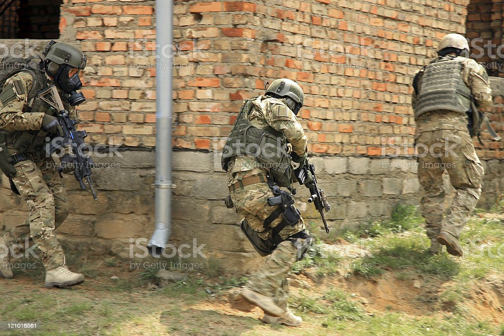 Three special forces soldiers in action royalty-free stock photo