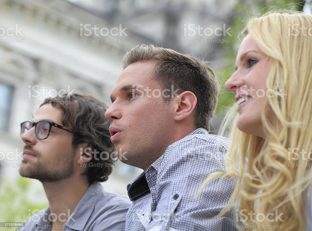 three spectators stock photo