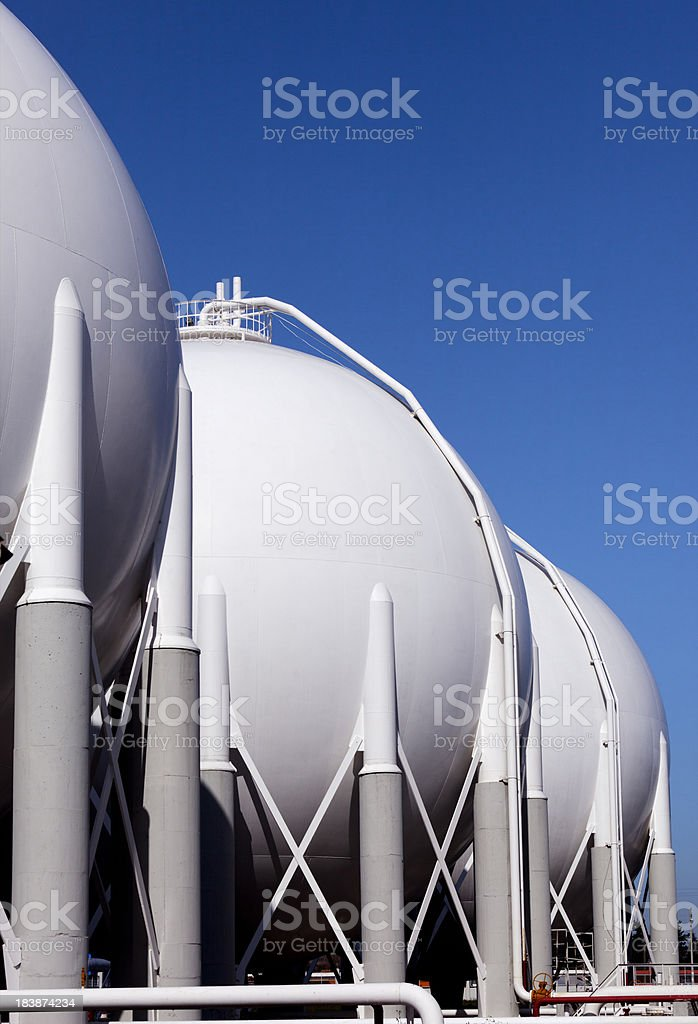 Three spherical storage tanks at a petrochemical plant royalty-free stock photo