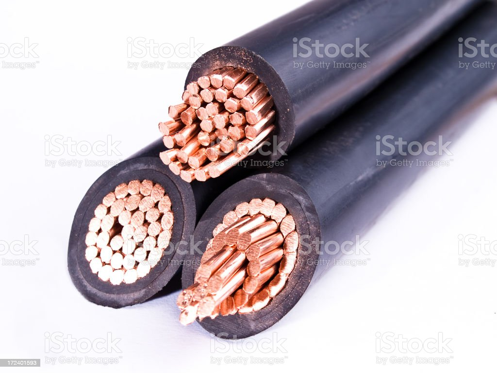 Three split black cables with inner copper wires showing royalty-free stock photo