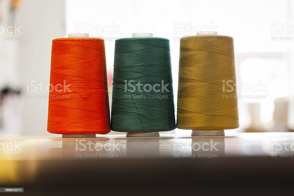 Three spools of sewing threads royalty-free stock photo