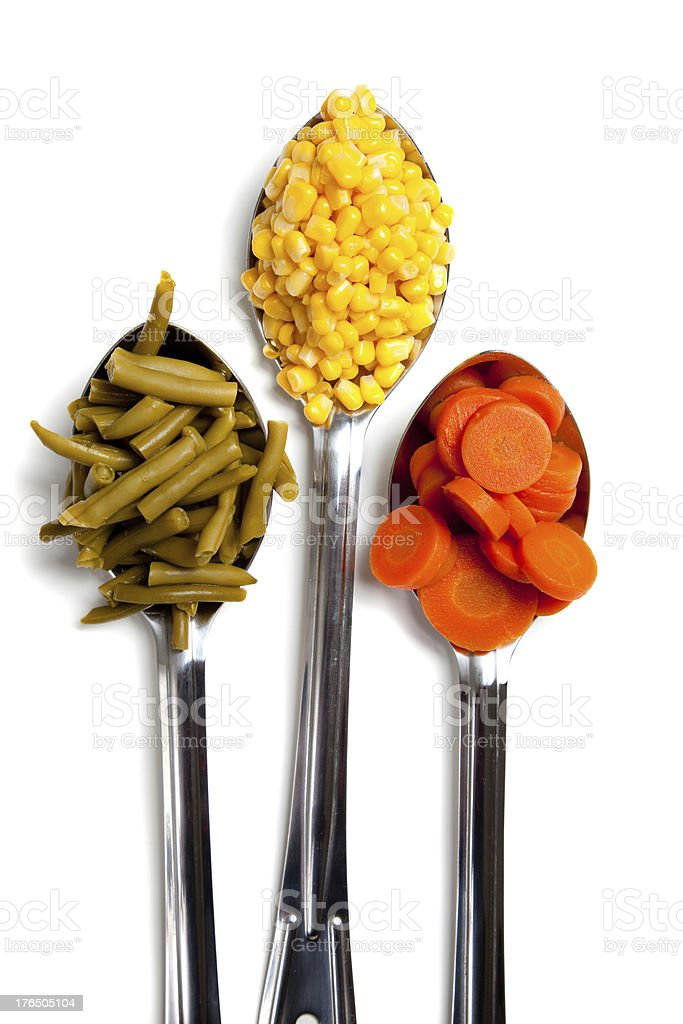Three spoons with vegetables on white royalty-free stock photo