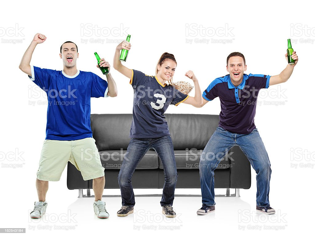 Three sport fans celebrating the victory royalty-free stock photo