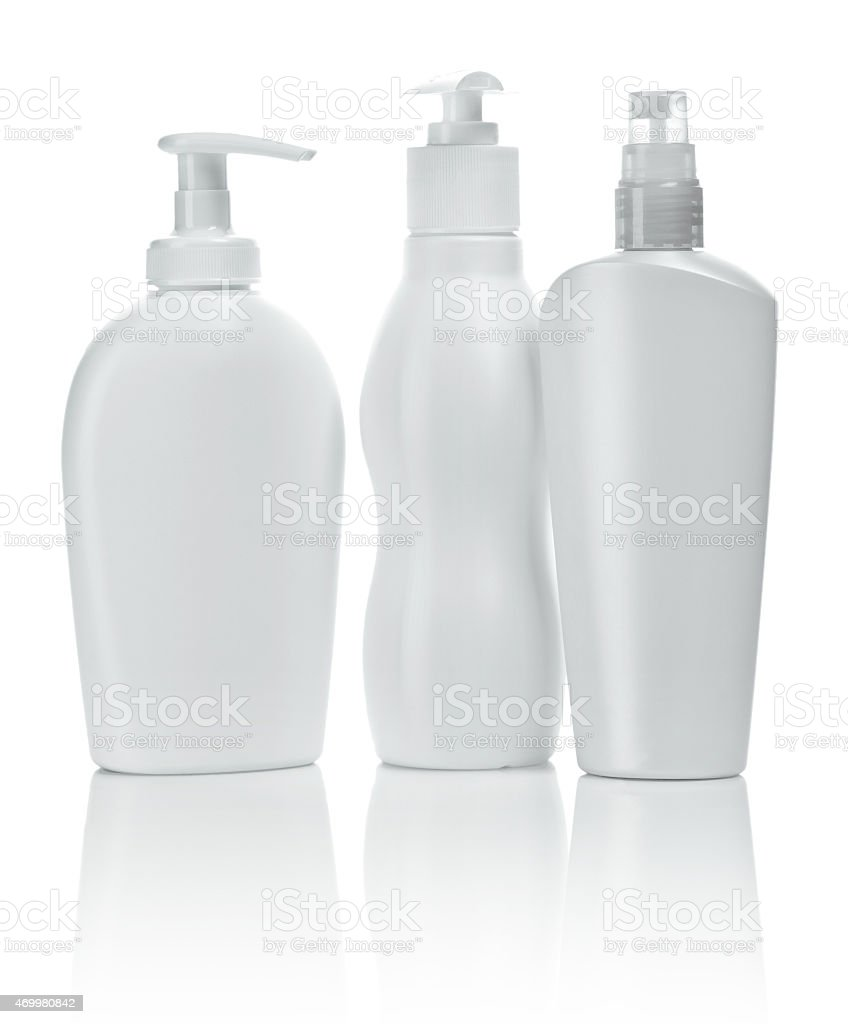 three spray bottles stock photo