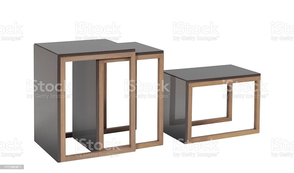 Three stackable coffee table being pull out stock photo