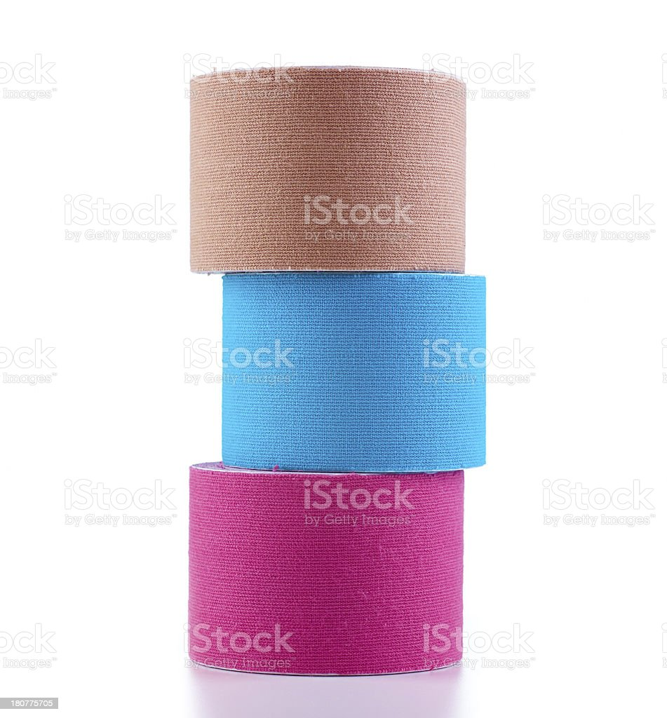 Three stacked rolls of colored tape stock photo
