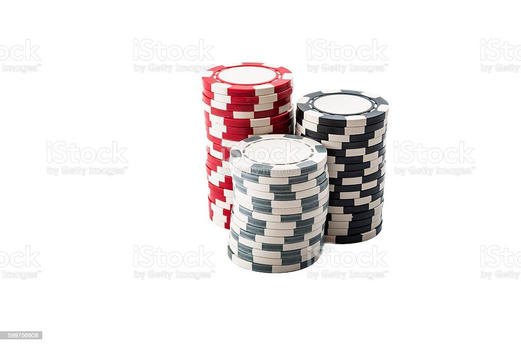 Three stacks of casino chips isolated on white stock photo