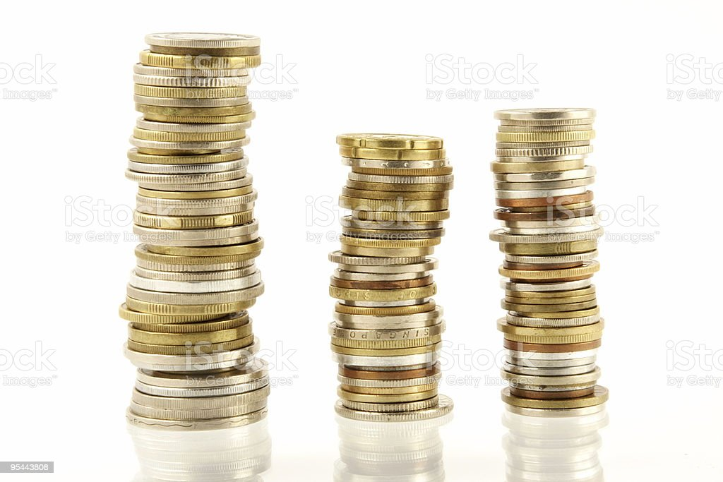 Three stacks of gold, silver and bronze coins on white royalty-free stock photo