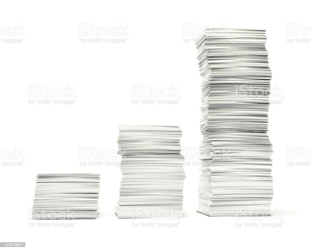 Three stacks of paperwork on white background stock photo