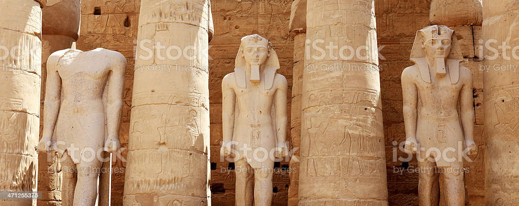 Three Statues in Peristyle Court of Amenhotep III stock photo