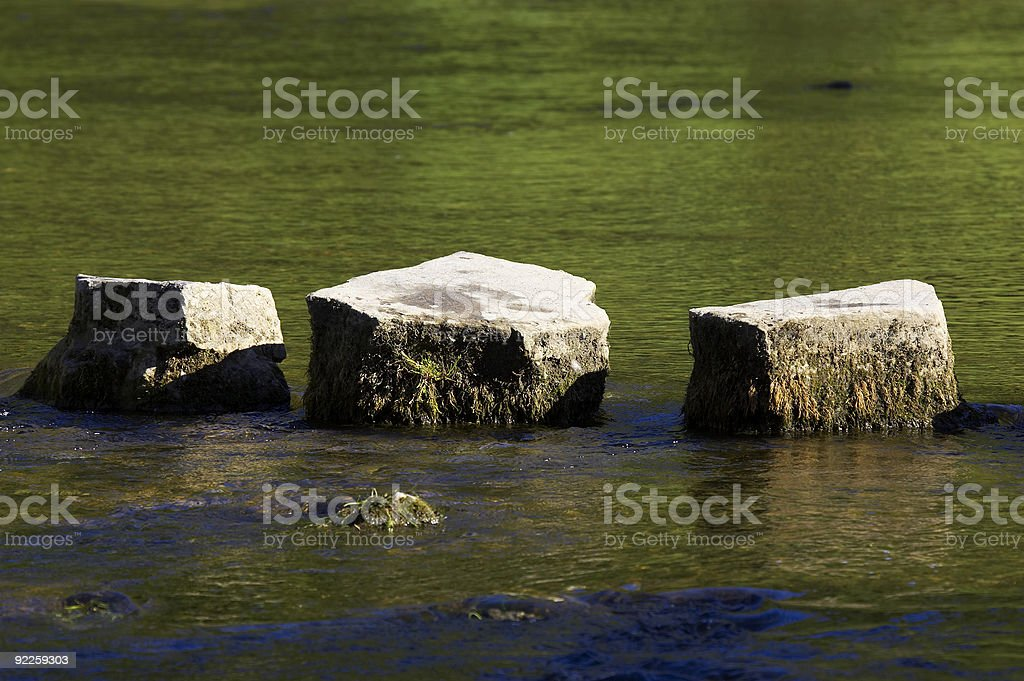 three stepping stones royalty-free stock photo