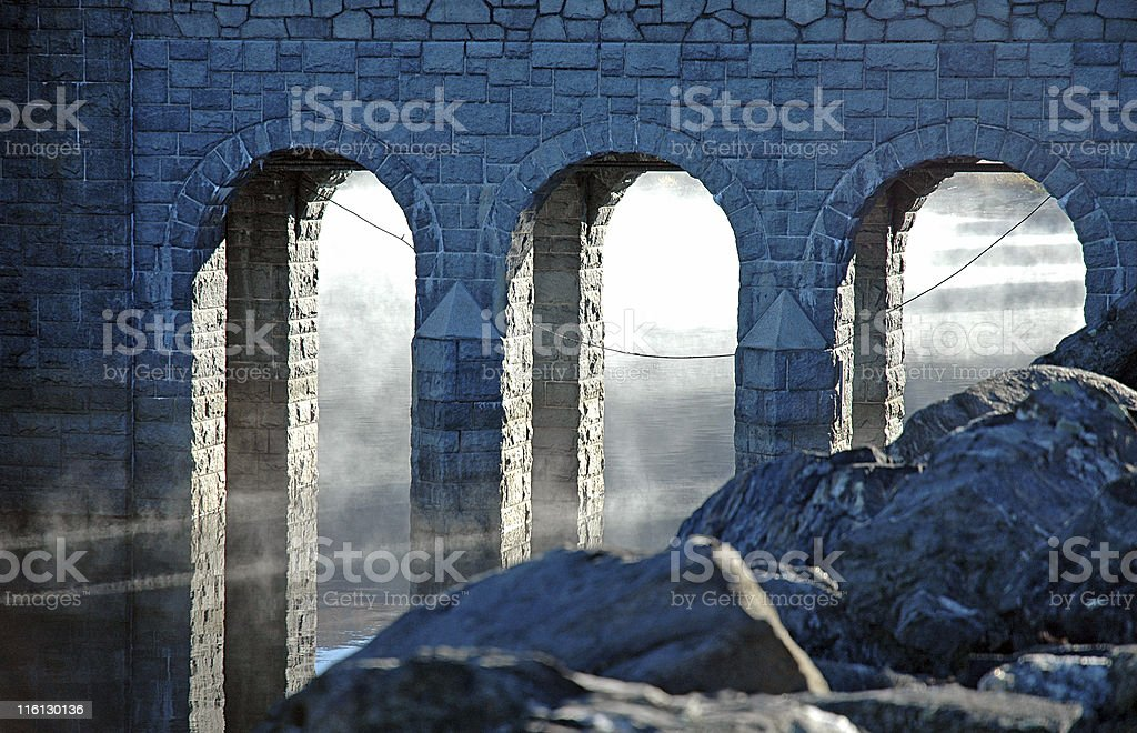 Three Stone Arches with Mist on Water stock photo