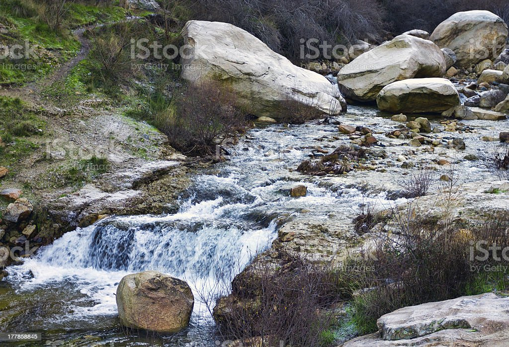 Three stones with a waterfall royalty-free stock photo