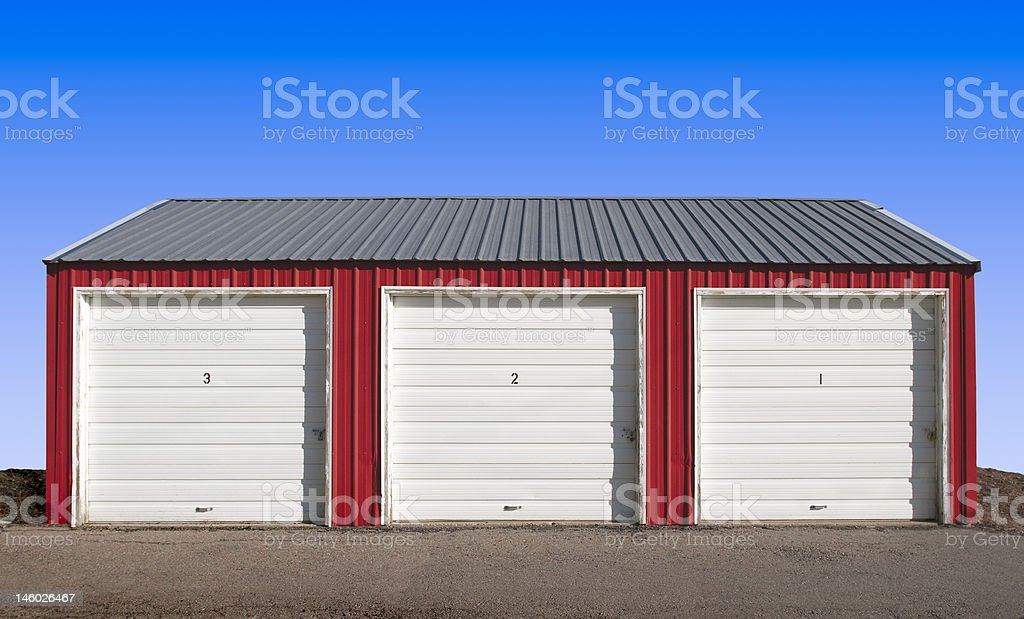 Three Storage Locker Doors with a Blue Sky Background stock photo