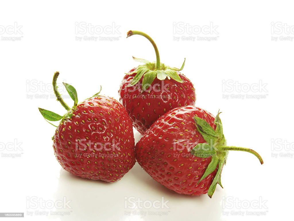 Three strawberry isolated on a white royalty-free stock photo