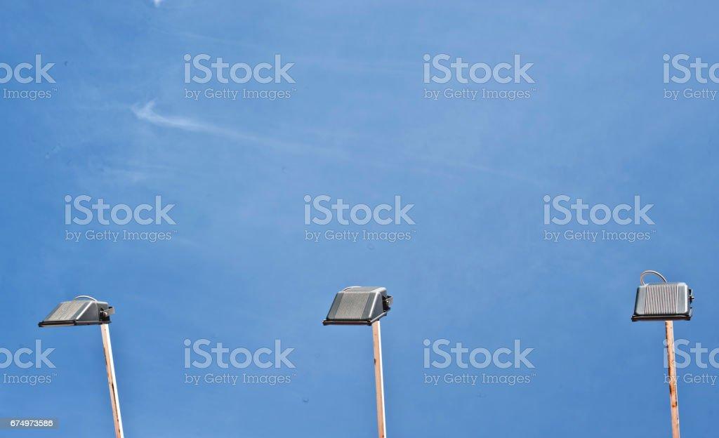 Three Street Lamps or Floodlight stock photo
