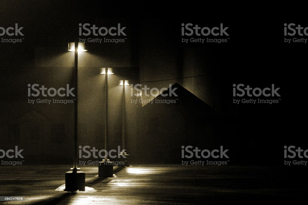Three Street lights in a parking lot stock photo