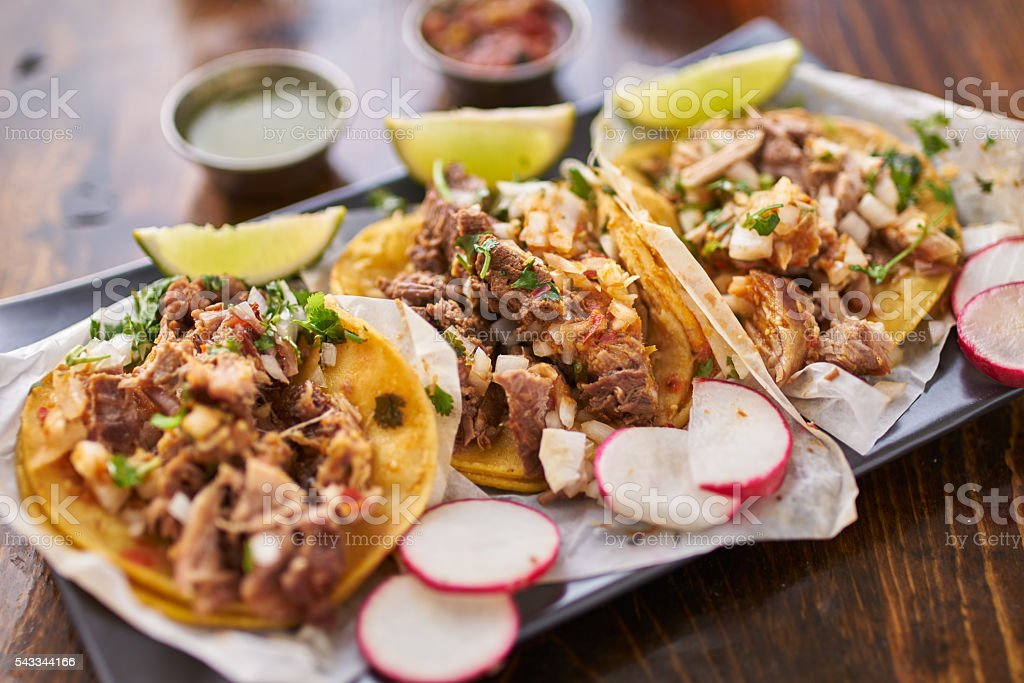 three street tacos in yellow corn tortilla with different meats stock photo